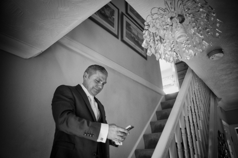 groom looking at phone