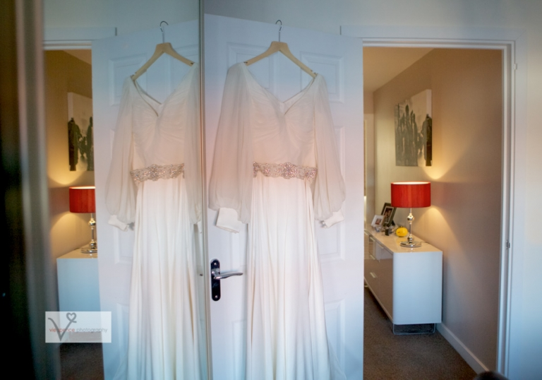 the bride's alan hannah dress hanging up